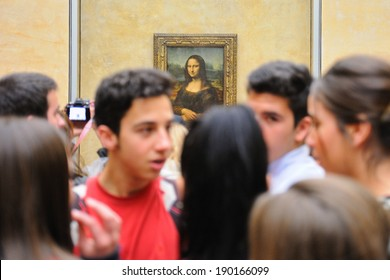 PARIS - MAR 3: Many tourists in front of the Mona Lisa (Monna Lisa or La Gioconda in Italian and La Joconde in French) painting at the Louvre Museum on March 3, 2014 in Paris, France.