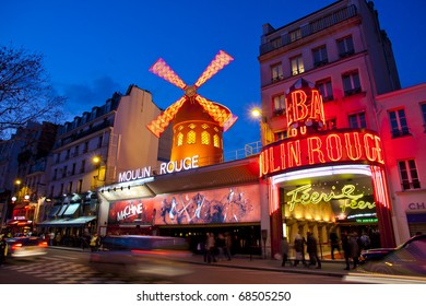 PARIS - MAR 3: The Moulin Rouge by night, on March 3, 2010 in Paris, France. Moulin Rouge is a famous cabaret built in 1889 and is located in the Paris red-light district of Pigalle