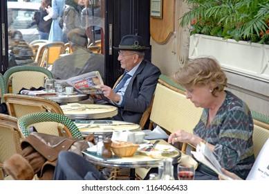 Paris - March 24, 2006: A typical day at Les Deux Magots cafe in Paris.