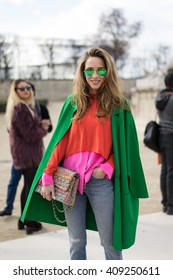 PARIS - MARCH 5, 2016: Stylish European woman during Paris Fashion week. With Fashion week in New York, London and Milan, they are the four biggest fashion events in the world.