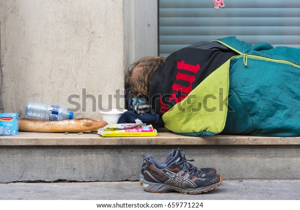 PARIS - MAY 08: Homeless man sleeping on a street in Paris on May 08. 2017 in France