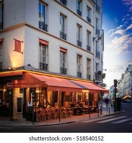 PARIS - MAY 1, 2016: Tourists at an outdoor cafe in Paris.