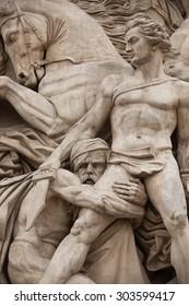 PARIS, MAY 17, 2013: Details of sculptures adorning the Arc de Triomphe, Paris, France