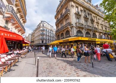 PARIS - MAY 21, 2014: Tourists walk in Quartier Latin. More than 30 million people visit Paris annually.