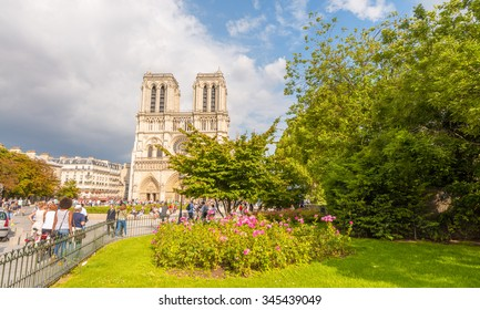 PARIS - MAY 21, 2014: Tourists at Notre Dame Cathedral. More than 30 million people visit Paris annually