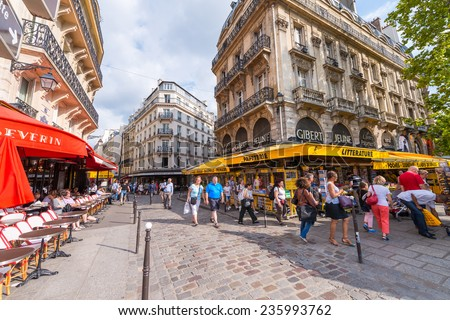 PARIS - MAY 21, 2014: Tourists walk in Quartier Latin. More than 30 million people visit Paris annually.