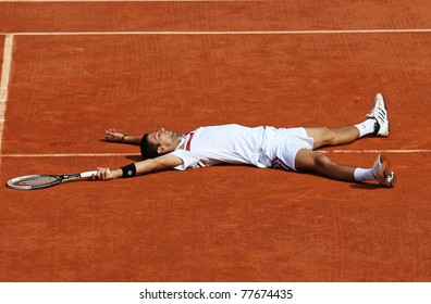 PARIS - MAY 21: Novak Djokovic of Serbia lies down at the centre court during the exhibition match  at French Open, Roland Garros on May 21, 2011 in Paris, France.