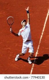 PARIS - MAY 23: Novak Djokovic of Serbia plays the 1st round match  at French Open, Roland Garros on May 23, 2011 in Paris, France.
