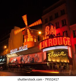 PARIS - MAY 28: The Moulin Rouge at night, on May 28, 2011 in Paris, France. Moulin Rouge is a famous cabaret built in 1889, located in the Paris red-light district of Pigalle.