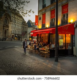 PARIS - MAY 29, 2016: Sidewalk cafe in the Marais neighborhood of Paris during the springtime.