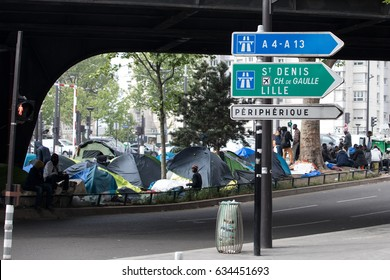 PARIS - MAY 5, 2017: Urban migrant camp on the ring road in northern Paris.