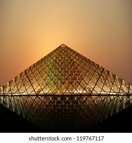 PARIS - MAY 8: Louvre Pyramid at dusk on May 8, 2012 in Paris, France. The Louvre is the biggest Museum in Paris displayed over 60,000 square meters of exhibition space