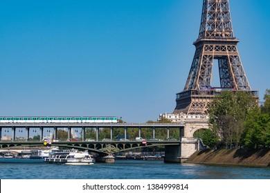 Paris metro crossing Pont de Bir-Hakeim and Eiffel Tower, France