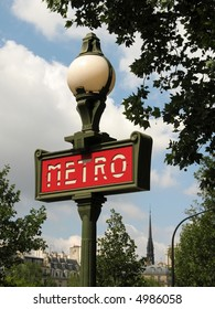 Paris metro sign for subway entrance on a summer day
