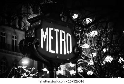 Paris Metro subway sign and Christmas illumination. Black and white. Retro style postcard.