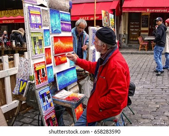 PARIS, MONTMARTRE, FRANCE - OCT 17, 2009 : Street artists, buyers and models on Montmartre hill. Montmartre Place du Tertre. They set up their easels each day for tourists in name of art and earnings