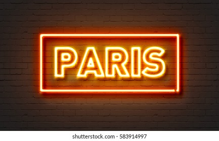 Paris neon sign on brick wall background