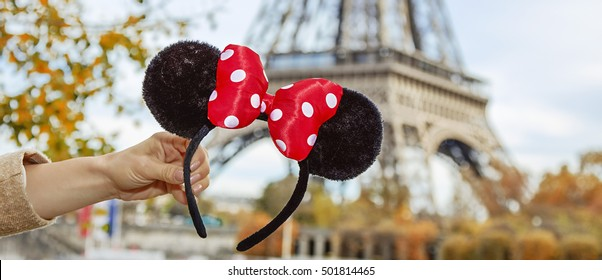 PARIS - November, 11, 2015: Closeup on Minnie Mouse Ears in female hand on embankment near Eiffel tower in Paris, France