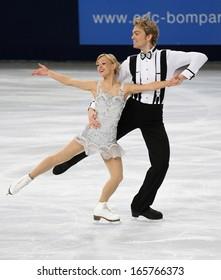 PARIS - NOVEMBER 15, 2013: Penny COOMES / Nicholas BUCKLAND of Great Britain perform short dance at Eric Bompard Trophy 2013 in Palais-Omnisports de Bercy, Paris, France.