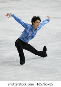 PARIS - NOVEMBER 15, 2013: Yuzuru HANYU of Japan performs during men's short skating event at Eric Bompard Trophy 2013 in Palais-Omnisports de Bercy, Paris, France.