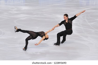 PARIS - NOVEMBER 16: Daria POPOVA / Bruno MASSOT of France perform at pairs short program event at Eric Bompard Trophy on November 16, 2012 at Palais-Omnisports de Bercy, Paris, France.