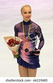 PARIS - NOVEMBER 27: Kiira KORPI of Finland poses at the medal ceremony after winning gold at Eric Bompard Trophy on November 27, 2010 at Palais-Omnisports de Bercy, Paris, France.