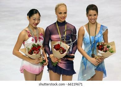 PARIS - NOVEMBER 27: Mirai NAGASU (L), Kiira KORPI, Alissa CZISNY during the medal ceremony of the ISU Grand Prix Eric Bompard Trophy on November 27, 2010 at Palais-Omnisports de Bercy, Paris, France.