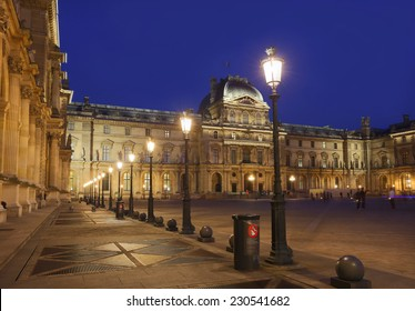PARIS - OCT 17 : Louvre museum at twilight in summer on October 17, 2014. Louvre museum is one of the world's largest museums with more than 8 million visitors each year.