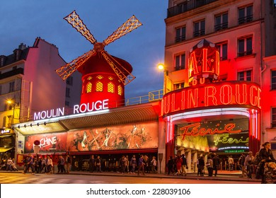 PARIS - OCT 29: The Moulin Rouge by night, on October 29, 2014 in Paris, France. Moulin Rouge is a famous cabaret built in 1889, locating in the Paris red-light district of Pigalle