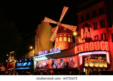 PARIS - OCT 29: The Moulin Rouge by night, on October 29, 2010 in Paris, France. Moulin Rouge is a famous cabaret built in 1889, locating in the Paris red-light district of Pigalle