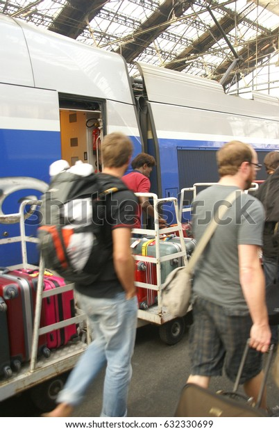 PARIS - OCT 3, 2011 - Passengers disembark the TGV high speed train at the Gare de Lyon railway station,  on Oct 3, 2011, in Paris, France.