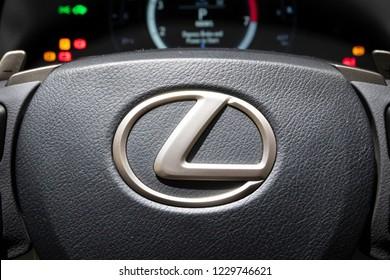 PARIS - OCT 3, 2018: Lexus logo on the steering wheel of a modern Lexus car at the Paris Motor Show.