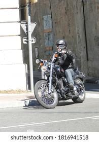 PARIS - OCT 5, 2011 - Man rides his motorcycle  near Rue des Rosiers, in the Marais district,  in Paris, France.