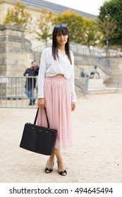 PARIS - OCTOBER 1, 2016: Stylish European woman with pink skirt during Paris Fashion week. With Fashion week in New York, London and Milan, they are the four biggest fashion events in the world.