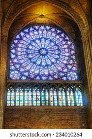 PARIS - OCTOBER 11: The North Rose stained-glass window of Notre Dame on October 11, 2014 in Paris, France. Its main theme is the Old Testament, but the central medallion depicts the Virgin and Child.