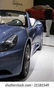 PARIS - OCTOBER 13 : People look at the Ferrari California at the 2008 Paris Motor Show October 13, 2008 in Paris.