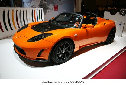 PARIS - OCTOBER 14: The Tesla Roadster electric automobile at the Paris Motor Show 2010 at Porte de Versailles, on October 14, 2010 in Paris, France