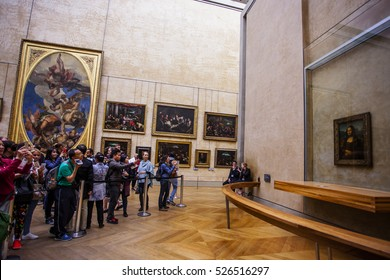 "PARIS - OCTOBER 2: Visitors take photo of Leonardo DaVinci's ""Mona Lisa"" at the Louvre Museum, October  2, 2016 in Paris, France. The painting is one of the world's most famous."