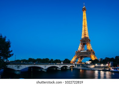 PARIS - OCTOBER 4: Eiffel Tower in festive illumination to Birthday (it is open on March 31 1889), view from the Seine quay, October 4, 2016 in Paris, France.