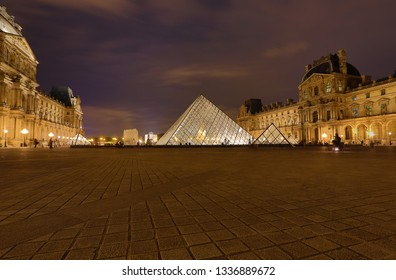 PARIS - OCTOBER 6, 2018 Louvre museum at twilight in summer. Louvre Museum is one of the world's largest museums, every year museum visits more than 8 million visitors.