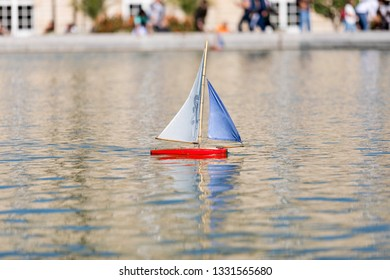 PARIS - OCTOBER 6: Children's ships in fountain near Luxembourg Palace in the Luxembourg Garden on October 6, 2018 in Paris, France. Toy ships is most popular entertainment on Luxembourg Garden.