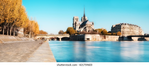 Paris, panorama over river Seine with Notre-Dame Cathedral from the back on a bright day in Autumn. This image is toned.