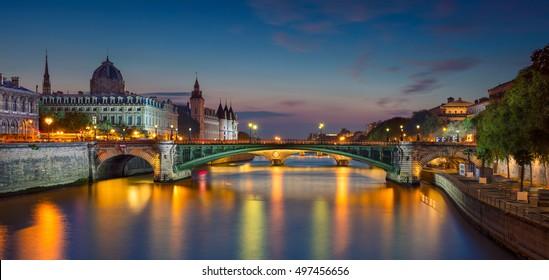 Paris Panorama. Panoramic image of Paris riverside during twilight blue hour.
