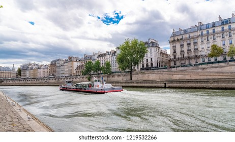 Paris, panorama of the quai de Conti, with a houseboat on the Seine