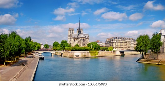 Paris, river Seine with Notre-Dame cathedral from the back on a bright day in Spring, panoramic image