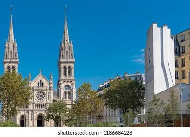 Paris, Saint-Ambroise church, boulevard Voltaire, the Truillot garden, public park, and modern buildings