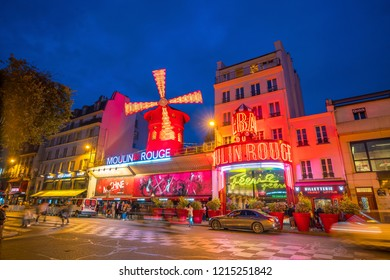 PARIS - SEP 14: The Moulin Rouge by night, on September 14, 2018 in Paris, France. Moulin Rouge is a famous cabaret theater built in 1889
