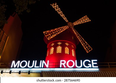 PARIS - SEPT 16, 2014: The Moulin Rouge at night. Moulin Rouge (French for Red Mill) is a famous cabaret and thater built in 1889, locating in the Paris red-light district of Pigalle. Paris, France.