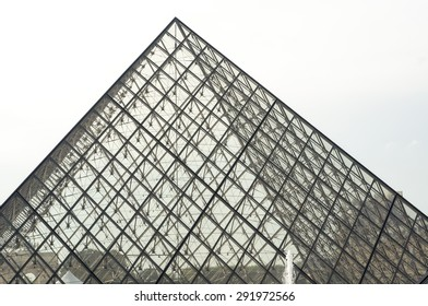 PARIS - SEPT 17, 2014: The Louvre IM Peis Pyramid. The Louvre Museum is one of the world's largest museums and a historic monument in Paris, France. A central landmark and popular place.