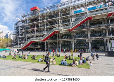 PARIS - SEPT. 21. 2018: People enjoying a warm spring day on the temporary grass set by Uber outside the Pompidou Center museum in Paris